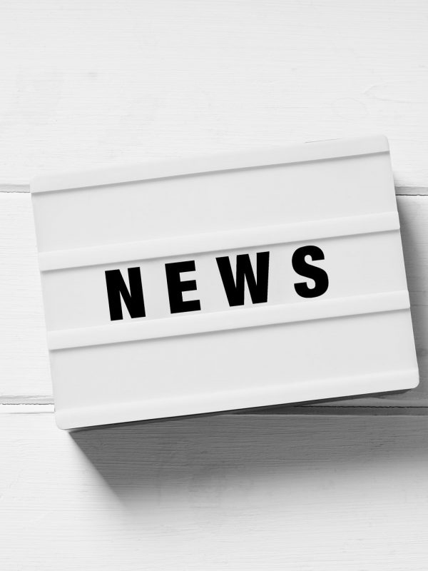 news text on light box sign on white wooden background